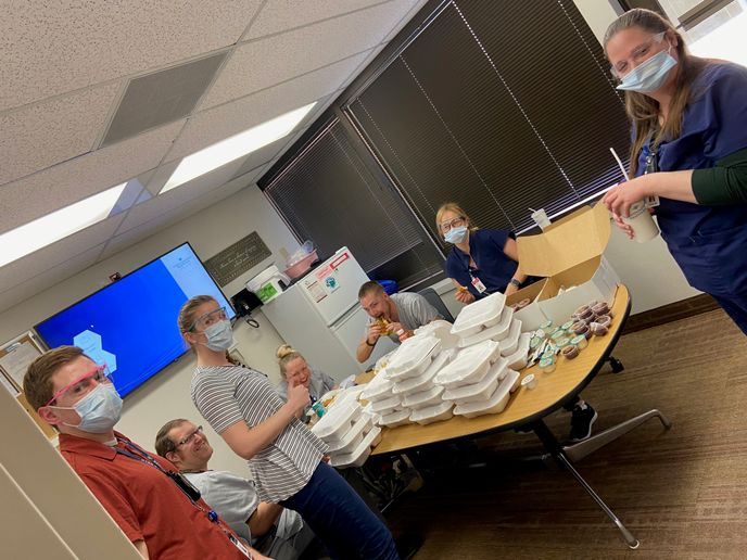 Nurses enjoy donated meals that Christie Stock and her employees purchased from local restaurants. Stock also is offering car service discounts for frontline workers. -