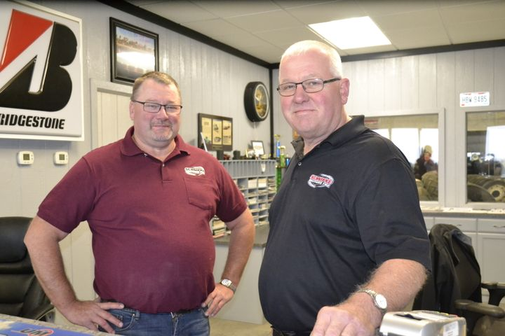 Kris (left) and Keith Schnipke are selling plenty of farm and commercial truck tires, which has made up for declines in their consumer tire sales. -