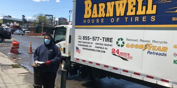 Barnwell House of Tires employees, like delivery driver Jose Herrera, are wearing personal...