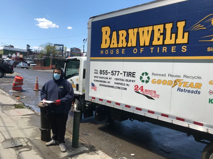 Barnwell House of Tires employees, like delivery driver Jose Herrera, are wearing personal protective equipment. -