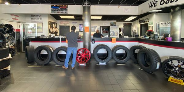 "Butler Tire built a ""wall"" of light truck tires to enforce social distancing at its sales counters."