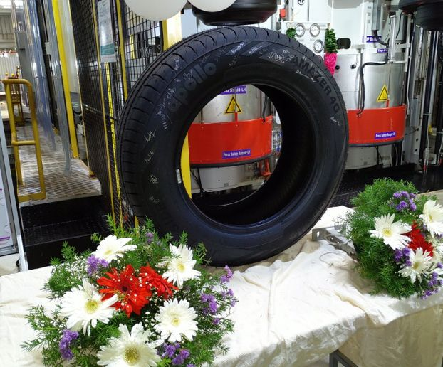 The first tire made atApollo's new plant has rolled off the assembly line. -