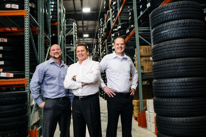 "Omaha, Neb.-based Jensen Tire & Auto is taking measures to preserve working capital. ""Inventory is a big thing,"" says President Matt Jensen (center, with sons Nick and Mike Jensen.) ""We're drawing inventories down and we're turning rubber into cash."" -"