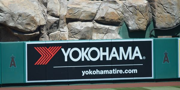 The outfield wall at Angel Stadium shows off Yokohama's sponsorship.
