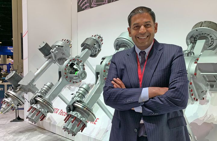 Chris Villavarayan, Meritor's senior vice president and president of Global Truck, with the new Meritor axles on display at the North American Commercial Vehicle show.