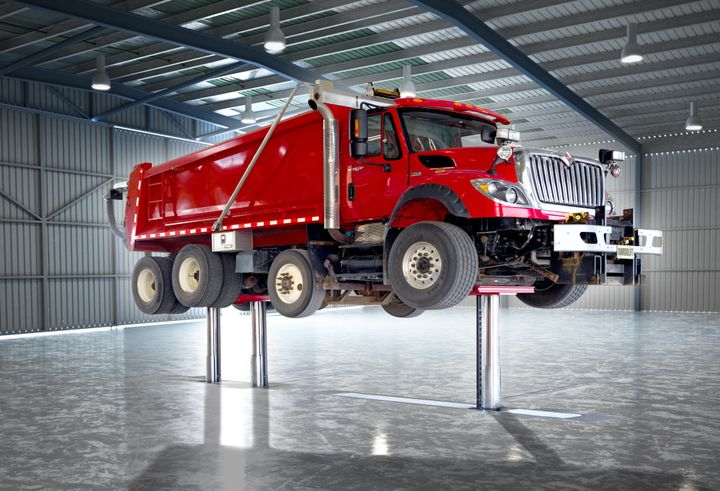 Stertil-Koni's Diamond three-piston lift allows easy access to wheel-ends, brakes and axles. When the lift is down, shop space can be used for other purposes.  - Photo: Stertil-Koni