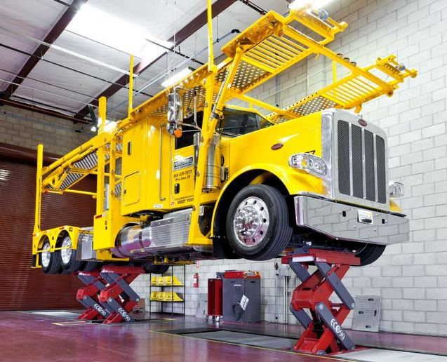 Scissor lifts are inground installations but require a shallower pit than a piston lift and use considerably less hydraulic fluid. -         Photo: Stertil-Koni