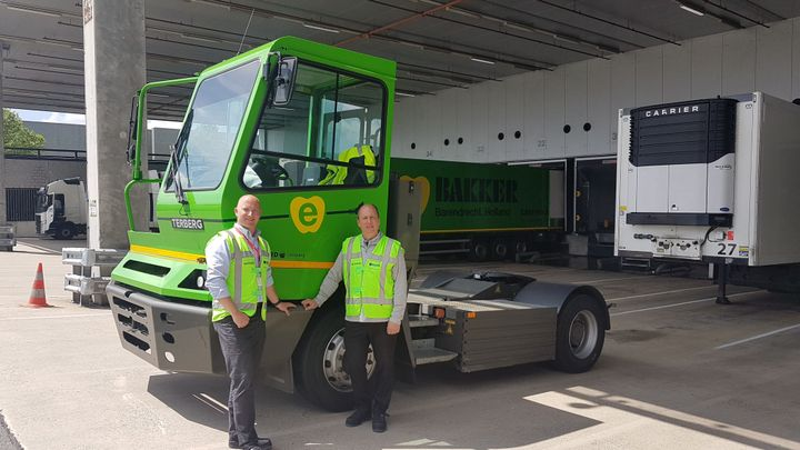 Train Trailer's James Currier presents Canada's first fully electric shunt truck to Loblaw's Wayne Scott in 2019. Tests are underway. -