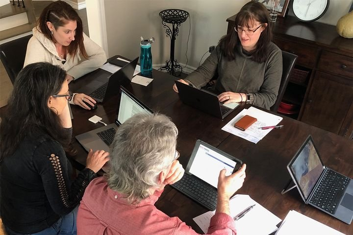 The Best Fleets to Drive For scoring team, featuring (Clockwise L-R): Courtney Muir, Christine Brooks-Wilson, Mark Murrell, and Jane Jazrawy gather around the kitchen table Jan. 7. - Photo: Todays' Trucking