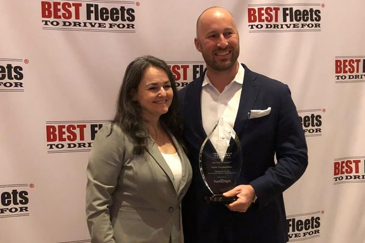 CarriersEdge CEO Jane Jazrawy presents Andrew Boyle, co-president of Boyle Transportation, with the Truckload Carriers Association's 2020 Best Fleets to Drive For award. - Photo: James Menzies