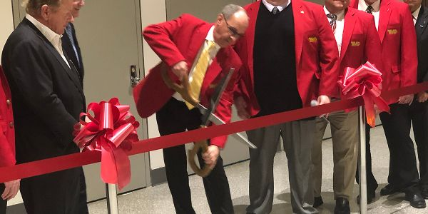 Chairman Kenneth Calhoun cuts the ribbon to open the trade show floor at this year's TMC Annual...