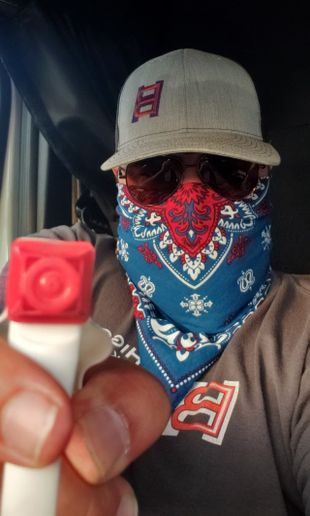 Before Higgins was able to procure masks, drivers were instructed to use bandanas. - Photo: Higgins Trucking