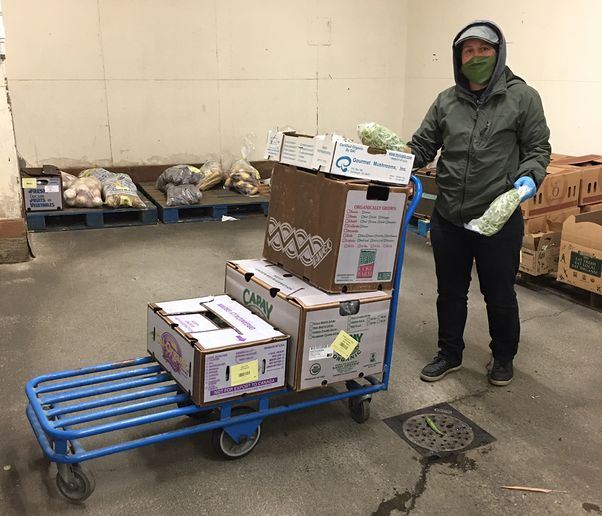 Warehouse workers are given masks and gloves to reduce the possibility of contracting COVID-19.