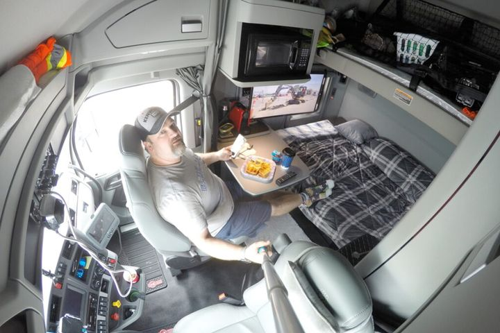 Roger Mansfield enjoys a meal in his own truck. - Photo: Roger Mansfield