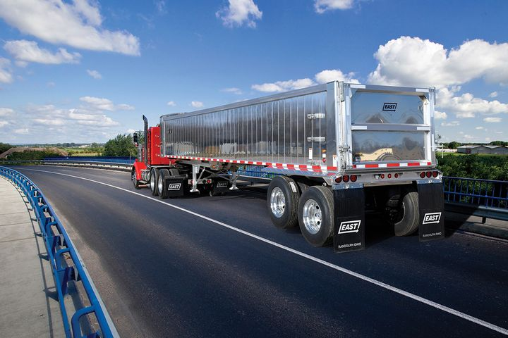 The ¼-inch-thick rear corner posts on East Manufacturing's new Narrow Spec Dump Trailer trailer wrap completely around the top and bottom rails and interlock to add strength, reducing side-to-side distortion. Its 2-inch-thick, double-wall extruded aluminum panels are robotically welded together vertically inside and out. - Photo: East Manufacturing