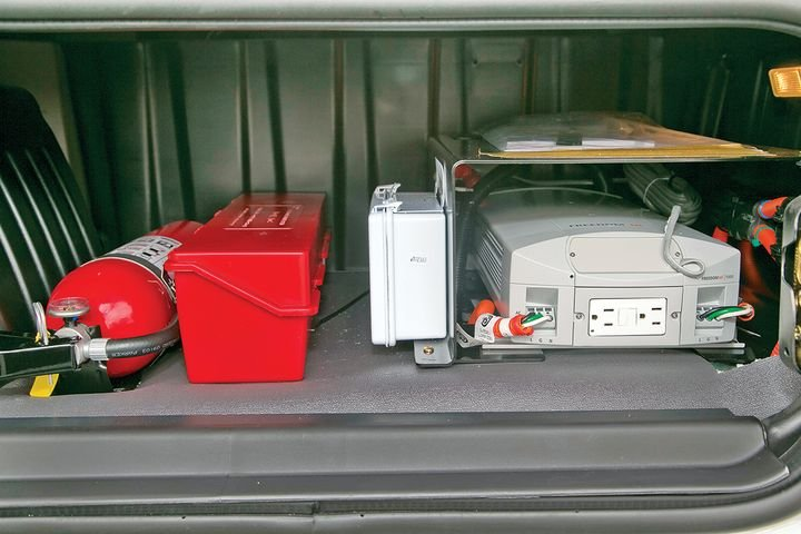 Inverters are usually installed under the bed or in a storage compartment. Care needs to be taken to protect the device from other objects in the compartment. - Photo: Xantrex