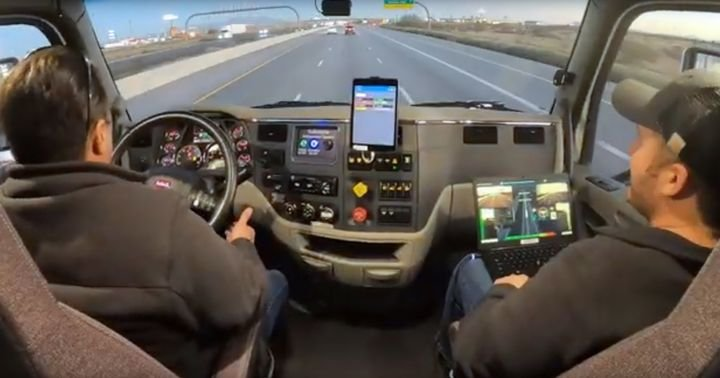 A TuSimple test driver (on the left) and software tech (right seat) pair to both keep the truck out of trouble and to teach the Autonomy how to drive the truck. 