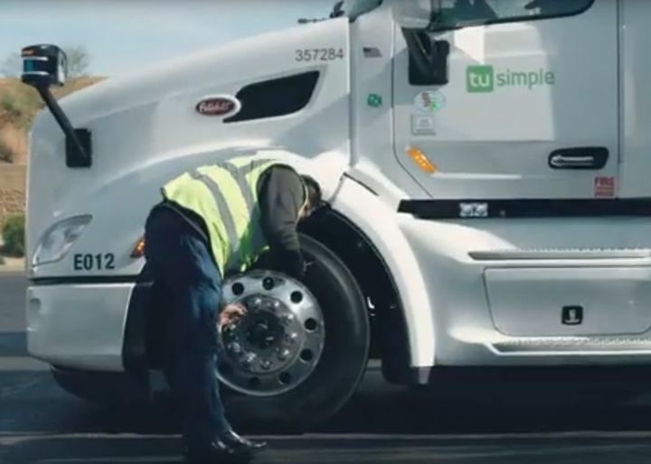 A TuSimple safety driver does a pre-trip inspection