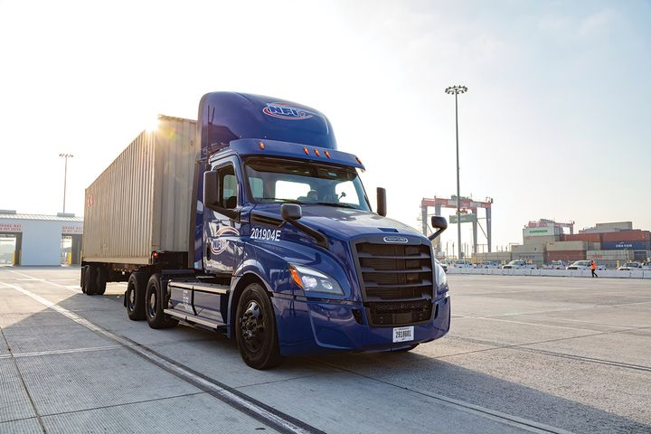 NFI is piloting electric trucks from Freightliner and Volvo. - Photo: NFI