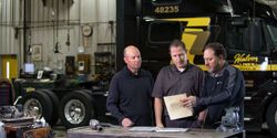 Adam Lang, right, with Halvor CEO Jon Vinje and insurance representative ChadHoppenjan from Cottingham and Butler, posing for a promotional photo for Halvor'sinsurance captive pre-COVID. Lang works with the shop on setting policies, safetytraining, and monthly safety walkthroughs.