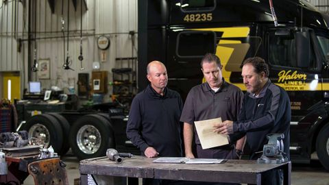 Adam Lang, right, with Halvor CEO Jon Vinje and insurance representative ChadHoppenjan from...