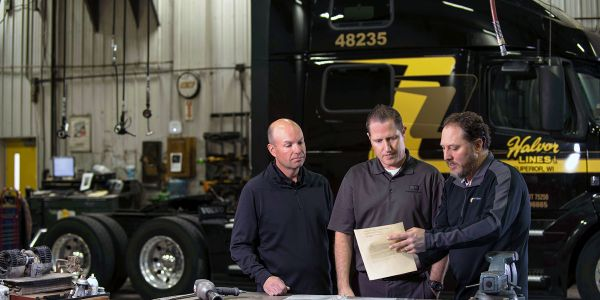 Adam Lang, right, with Halvor CEO Jon Vinje and insurance representative ChadHoppenjan from...