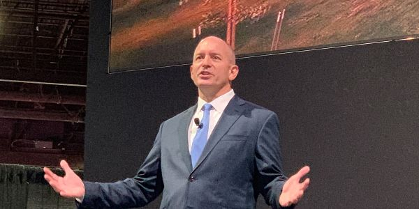 Roger Nielsen speaks at the North American Commercial Vehicle Show in 2019.