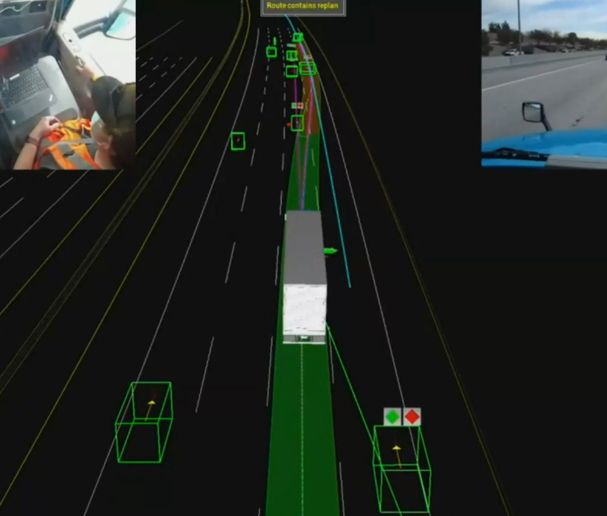 This digital view shows the truck from an elevated position behind the truck. Present on the screen are the roadway lanes and shoulders as well as pertinent markings such as exit and on ramps. - Screenshot: Waymo Live Ride Demo