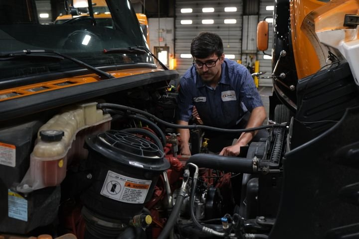 A. Duie Pyle has an apprenticeship program in which high-achieving students from post-secondary technician programs are hired and work side-by-side with journeyman technicians for a year. Shown: Apprentice Jesse Armendariz performs a repair on a Cummins engine. - Photo: A. Duie Pyle
