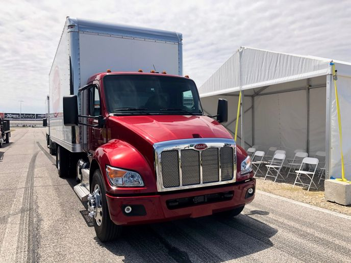 A new, wider cab, sharply sloped hood, new instrument display screen and standard advanced driver safety systems are among the new driver-focused features on Peterbilt's just-launched medium duty truck line. - Photo: Jack Roberts