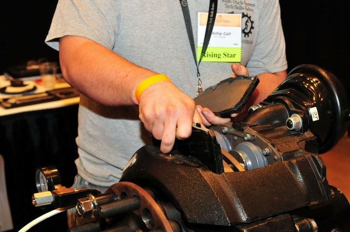 An up-and-coming technician demonstrates a disc brake pad change during Rush Truck Centers Tech Skills Rodeo, designed to foster skills development. - Photo: Jim Park