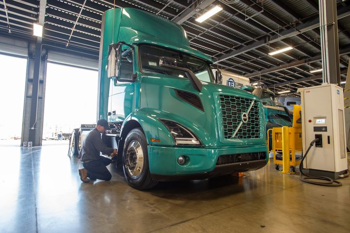 Dealers are starting to prepare for sales and maintenance of electric trucks. Here, a tech inspects a Volvo VNR Electric at TEC Equipment dealership in Fontana, California, the first location to achieve Volvo's electric vehicle certification. - Photo: Volvo Trucks North America