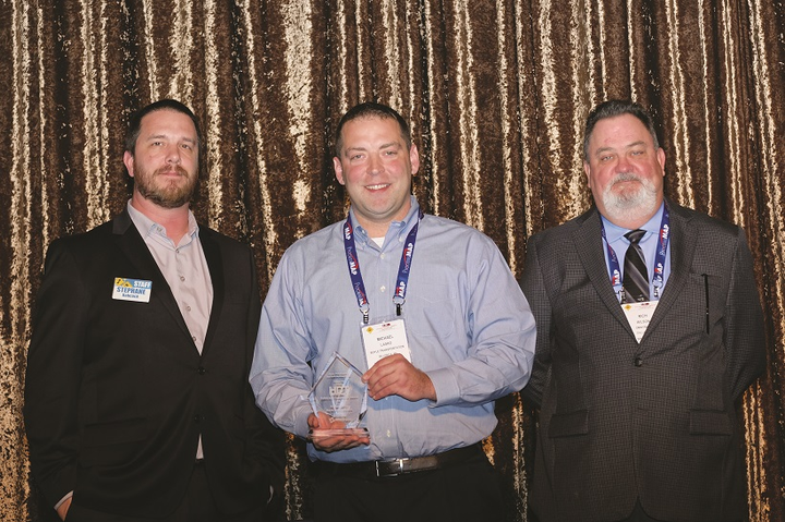 Michael Lasko (center) was on hand to accept his award from Managing Editor Stephane Babcock (left) and Rich Wilson (right), senior sales manager of Omnitracs, at the 2018 Fleet Safety Conference in October.  - Photo: Jim Park