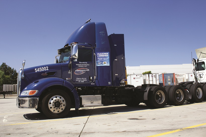 NFI is testing electric trucks in drayage operations and uses natural gas power in some locations.
