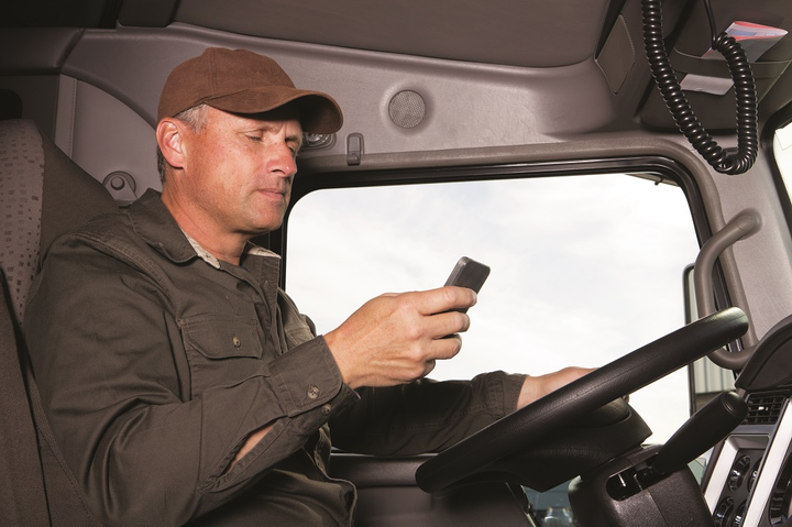 In the age of mobile technology, distracted driving is a major issue for truck drivers.  - iStockPhoto.com/shotbydave