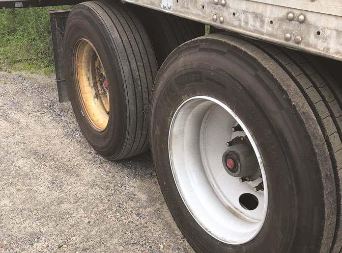 Sometimes spotting a mismatched older tire with a newer tire on a dual axle is simple.