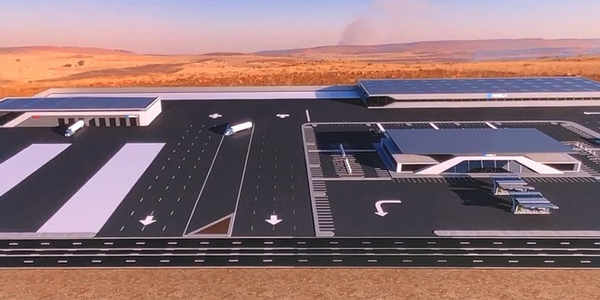 "Concept drawing of the ""truck stop"" facility that will surround many of Nikola's generation and..."