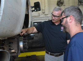 Paul Cupka chats with technician Scott Duvall about tire repair issues. Cupka is Fairfax...