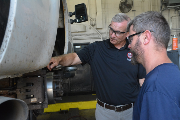 Paul Cupka chats with technician Scott Duvall about tire repair issues. Cupka is Fairfax County's Department of Vehicle Services West Ox Maintenance Facility superintendent.