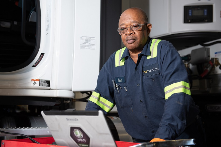 Today's technicians use a computer as much as a wrench – a message fleets are trying to get across to young people looking for career options. - Photo: Transervice