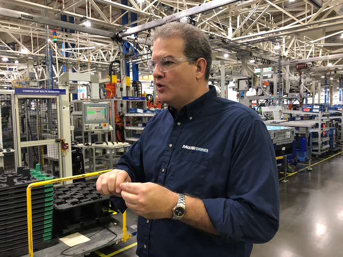 Lance Walters, plant manger of the Paccar Engine Company's Columbus Engine Plant in Columbus, Mississippi, briefs journalists on production techniques during a tour of the facility.