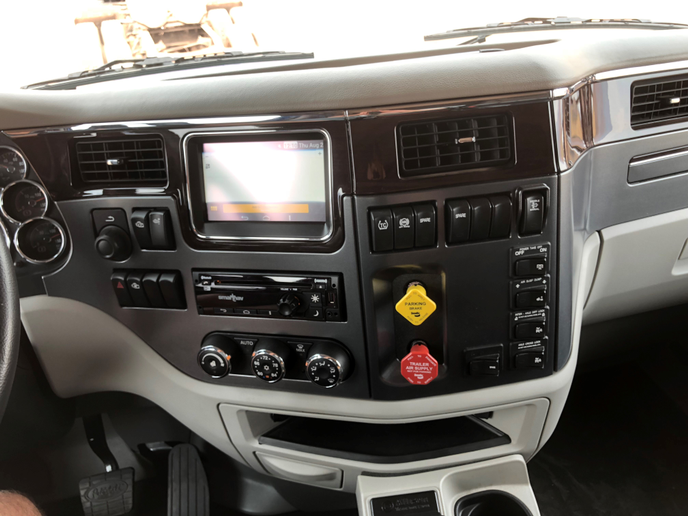 Many of the driver features finely honed in Peterbilt's long-haul models are now standard in Model 567 cabs, including Paccar's center dash-mounted infotainmnent system.  -