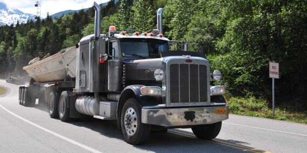 Consider how much energy is required to get a loaded truck to the top of a mountain grade. An...