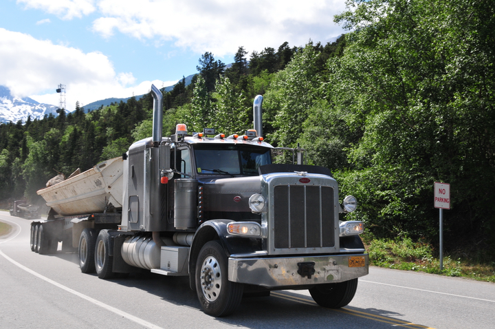 Consider how much energy is required to get a loaded truck to the top of a mountain grade. An equal amount of energy must be dissipated in the form of heat to bring the truck safely down the mountain.