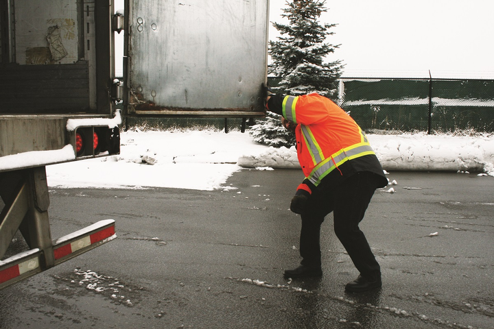 Safety vests containing pockets mean drivers aren't trying to climb with something in their hands. Drivers need to be aware that wet conditions can be slippery for them as well as for their trucks.