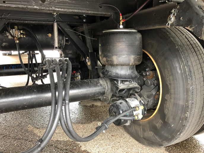 Hendrickson's Zero Maintenance Damping system looks much like any other air suspension except it has no shock absorbers. A down-stop to prevent over extension now occupies that space.