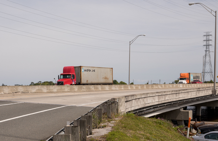 High winds before, during and after a hurricane can easily topple a fully loaded trailer on bridges on elevated roadways.