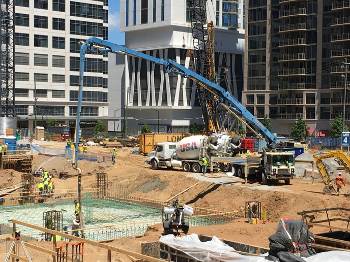 Concrete pumps deliver building material with a high degree of accuracy, but the work involves a race against the clock.  -