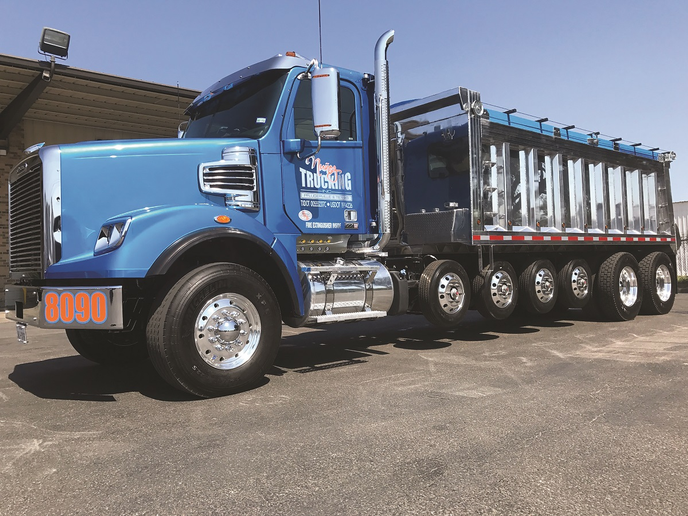Freightliners are not often chosen by fellow dump truckers, says Peter Nuñez, who got this one new in autumn of 2017. But it's well built, reliable, and so comfortable that its driver raves about it. The aluminum body is from Houston Dump Trailers. 