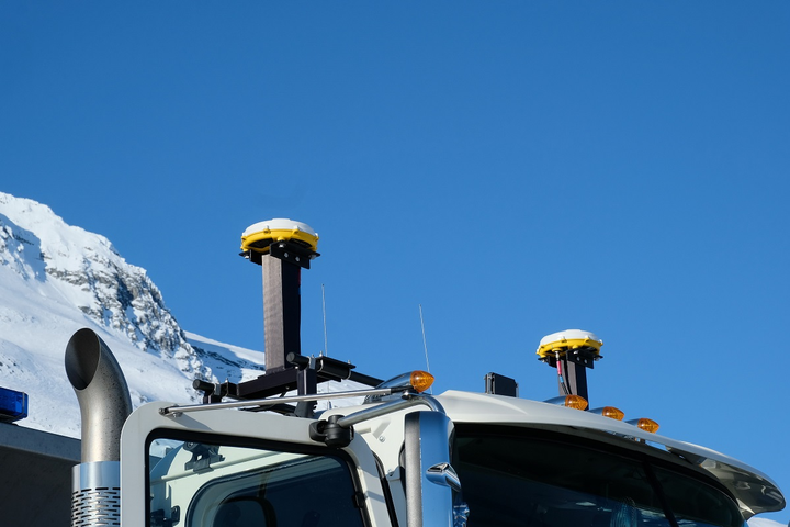 Two roof-mounted GPS receivers guide the trucks by tuning into two separate GPS satellite constellations, the public side of the US military GPS and the Russian GLONASS.  